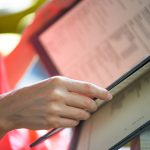 Woman holding restaurant menu, selective focus