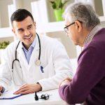 Doctor explaining prescription to senior patient, healthcare concept