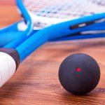 Close up of a squash rackets and balls